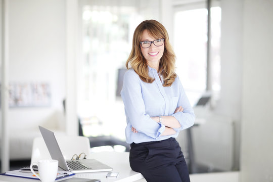 Executive businesswoman standing at office