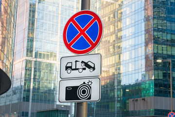 Road Sign - No Stopping. Work tow and photofixation