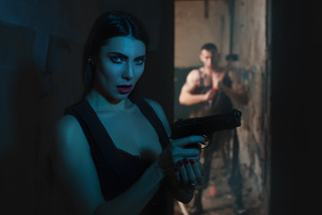 Woman with a gun.