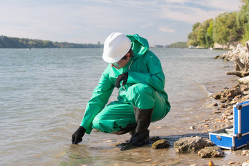 Pollution control inspector filling up sample container