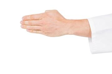 Karate player making hand gesture on white background