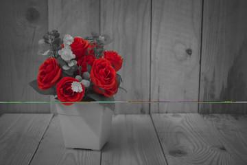 Red flowers on black wood scene