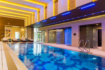 Interior swimming pool in luxury hotel spa center