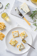 Crackers with gorgonzola and herb and white wine jelly