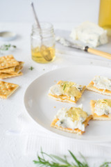 Crackers with gorgonzola and herb and white sweet wine  jelly. Selective focus