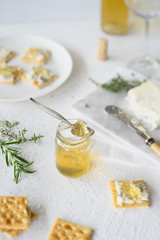Homemade herb and white sweet wine  jelly to pair with crackers and blue cheese. Selective focus