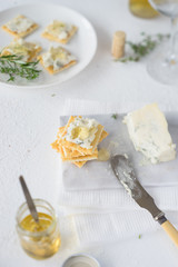 Crackers with gorgonzola and herb and white wine  jelly. Selective focus