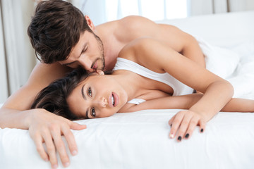 Young passionate couple in bed