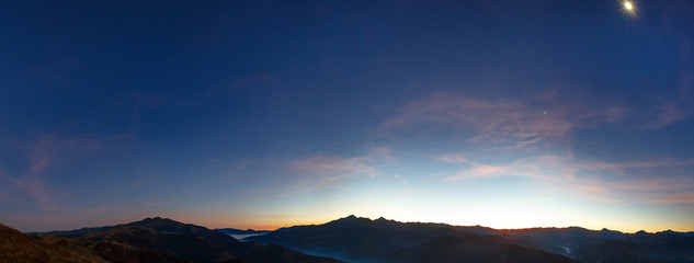 Early predawn in mountains.