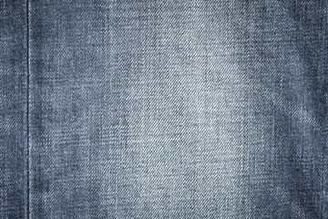 Closeup denim jeans texture. Stitched textured blue denim jeans background. Old grunge vintage denim jeans. Denim jeans fashion design. Dark edged.