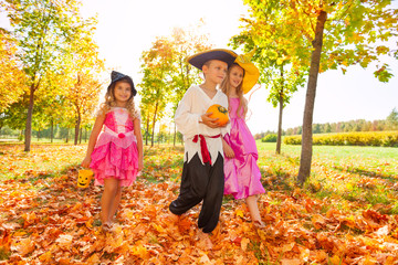 Children in costumes during Halloween, forest