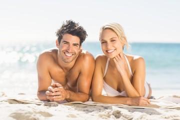 Young couple lying on beach