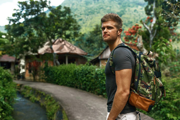 Travel And Tourism. Tourist Man Adventure On Summer Vacation. Beautiful Handsome Free Happy Cheerful Young Male Traveler Enjoying Nature Beauty Of Forest In Summer. Hike, Healthy Active Lifestyle