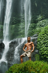 Water. Healthy Man With Sexy Body Near Waterfall. Healthcare