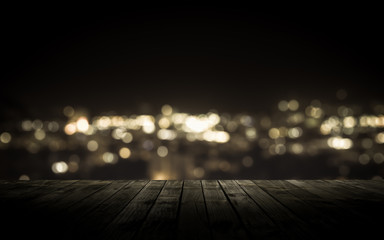 Wooden plank above the town at night