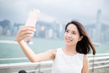 Woman taking cellphone at Hong Kong