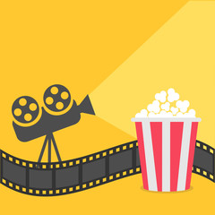 Popcorn. Film strip border. Cinema projector with ray of light. Cinema movie night icon in flat design style. Yellow background.