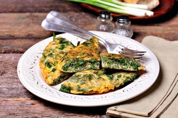 Scrambled eggs with parsley, dill, coriander and green onions. Breakfast.