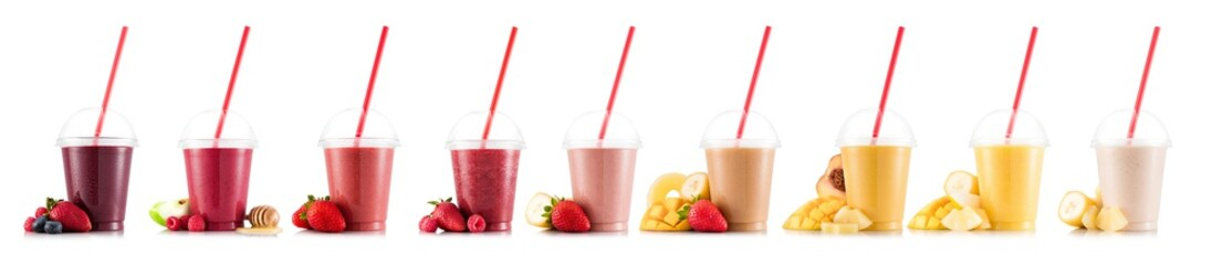Nine, multifruit smoothies isolated on white, in plastic cup with fruits