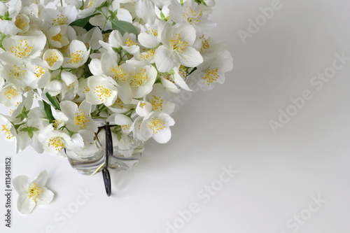 Bouquet Of White Jasmine Flowers In A Vase Corner Of Frame From