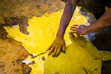 One man working in a tannery in the city of Fez in Morocco.