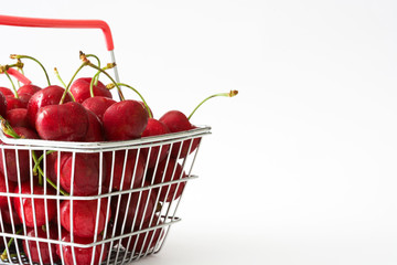 Cherries in a shopping basket isolated on white background