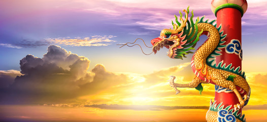 Golden Chinese Dragon at sunset in the twilight background, Dragon statue Chinese style, Chinese style dragon statue concept for background.