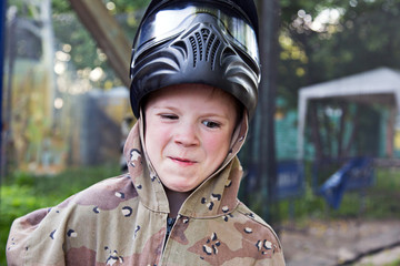 Boys dressed in camouflage uniforms. Paintball