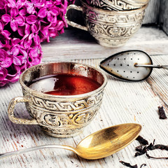 Wall Mural - Still life with tea and branch of lilac