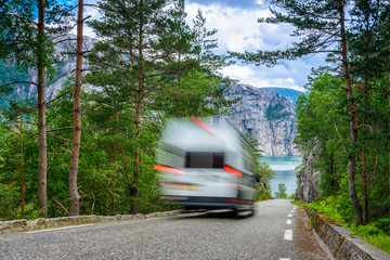 RV on a mountain road in Norway - in a hurry for vacation