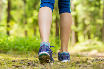 Walking or running legs in forest, exercising in summer nature.T