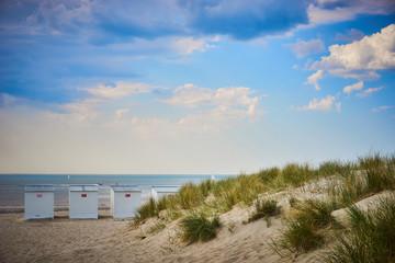 Sandy beach of North Sea / Roofed beach chairs at beach of Nieuwpoort in Belgium