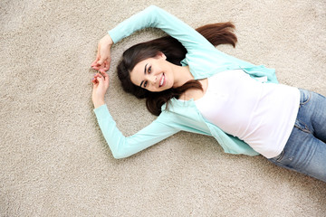 Beautiful girl lying on floor