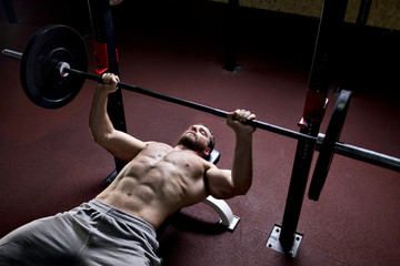 Young man doing exercise in gym