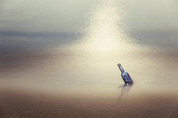 Bottle with message in sea at dusk