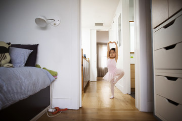 Litle girl practicing dance at home