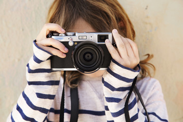 Close-up of boy photographing with camera