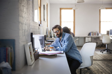 Man working on laptop in office