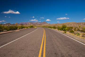 Beautiful cinematic view of the road under the blue cloudless sky in America
