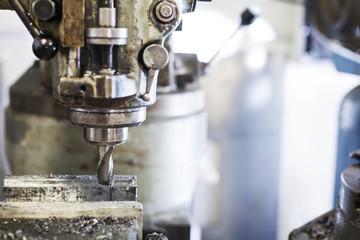 Close-up of drill machine at auto repair shop
