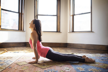 Woman exercising on carpet at home