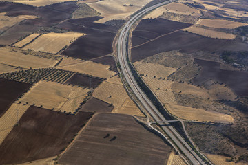 Aerial view of roads amidst cultivated landscape