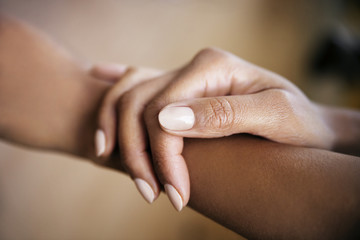 Cropped image of woman touching hand