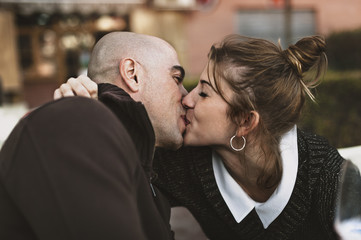Close-up of couple kissing outdoors