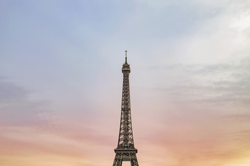 Low angle view of Eiffel Tower against cloudy sky during sunset
