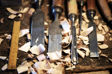 High angle view of work tools and shavings on table