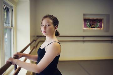 Portrait of ballet dancer standing at dance studio