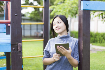 Woman Use Tablet for Relaxation at Playground