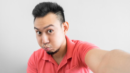 Man take selfie with duck face.