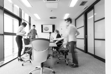 business people group entering meeting room  motion blur